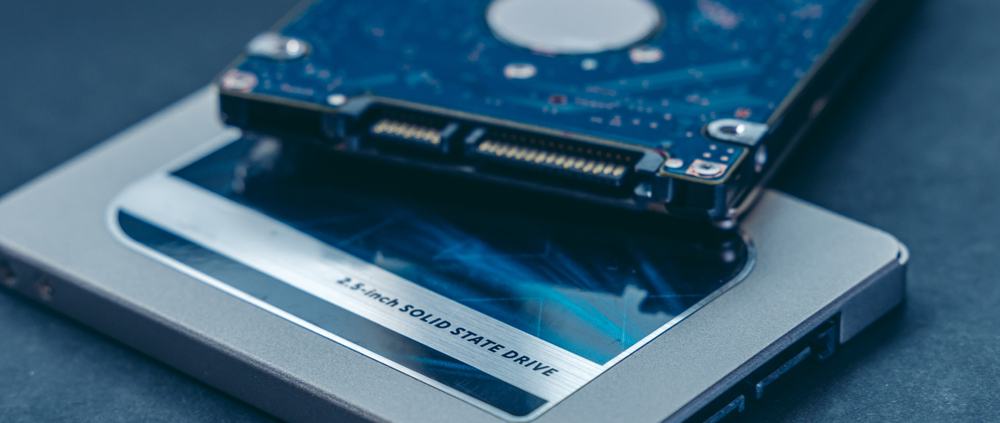 Solid State Drive vs traditional HDD, isolated. Fast storage device vs slow.